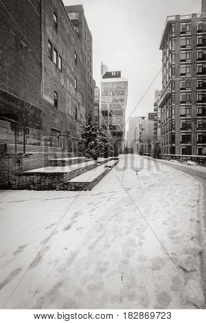 Winter view of the High Line covered in snow in Black & White. A quiet moment in the heart of Chelsea Manhattan New York City