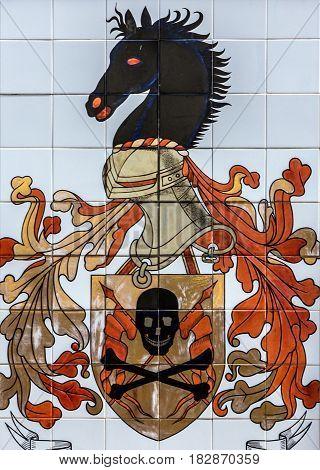 Lisbon, Portugal - April 2, 2017: Ceramic tile in Lisbon street Portugal emblem of fire brigade.