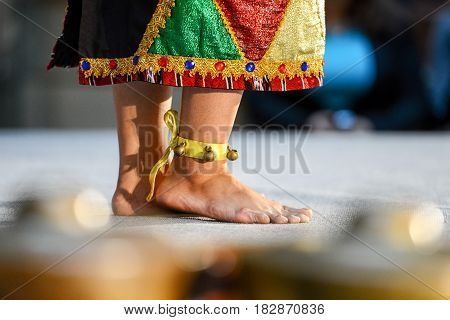 Indonesian dancers legs with bells. Close-up photography.