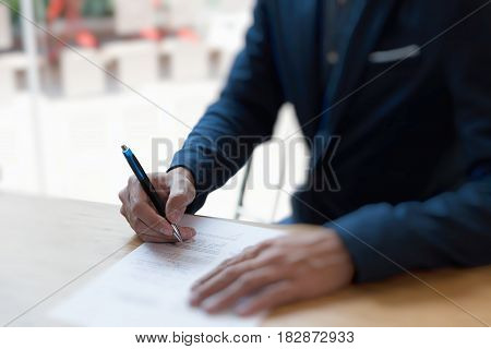 Businessman sign contract. Manager signing paper document at work. Starting partnership at headquarter.