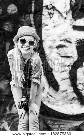 Portrait Of Smiling Hipster Girl With Retro Photo Camera Against Urban Wall Outdoors