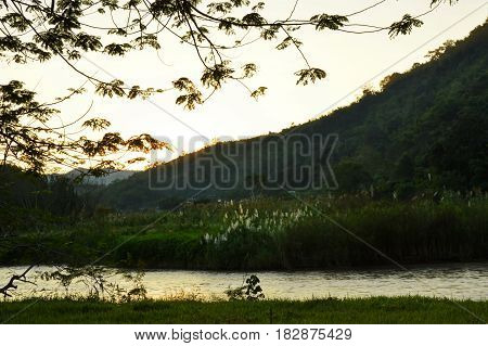 river flow and mountain background on sunset