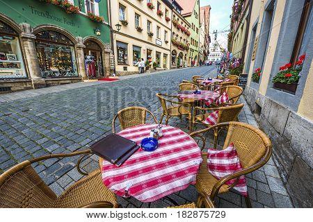 Rothenburg ob der Tauber, Germany - September 2017:  street cafe tables