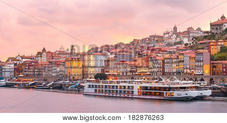 Panorama of Ribeira, Old town of Porto and the Douro River at pink sunset, Portugal, Portugal.