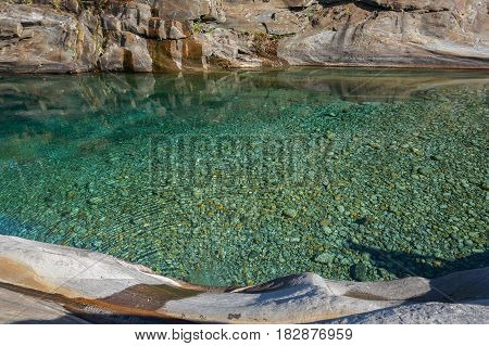 crystal clear green see through water river outdoor on day light