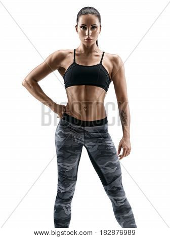 Strong girl with beautiful muscular body posing on white background. Beauty and body care concept