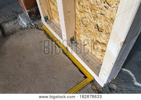 Close up detail of house construction wooden wall elements. Interior frame renovation work