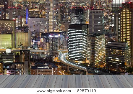 Opening wooden floor Osaka city central business downtown night view Japan