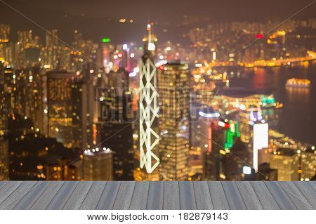 Opening wooden floor Hong Kong city blurred bokeh light night view abstract background