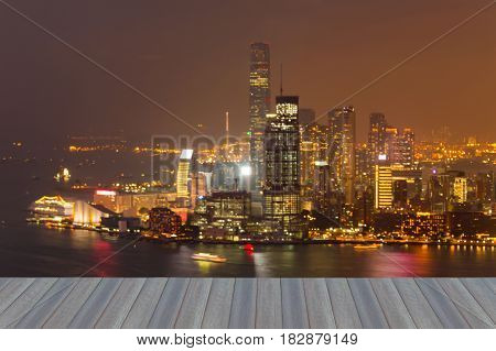 Opening wooden floor Hong Kong city blurred bokeh light over Victoria bay abstract background