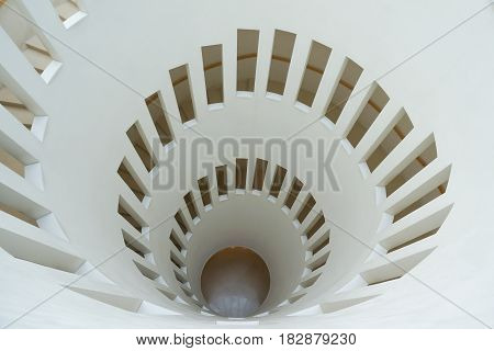 South Korea - March 11 2014: Top view of White spiral staircase in Samsung Museum. In Seoul South Korea