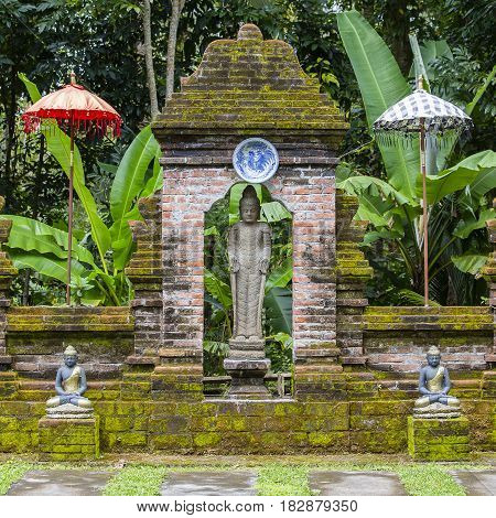 Buddha statue in a Buddhist monastery on the island of Bali Indonesia.