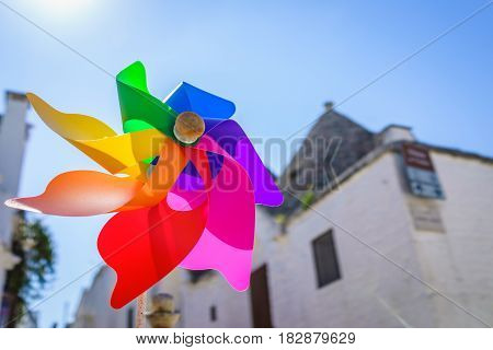 Closed up shot of colorful rainbow pinwheel in sun shine summer day.