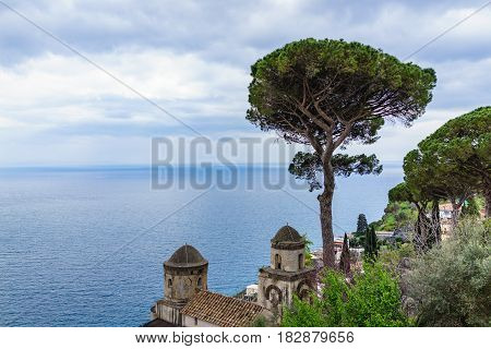 View of Italian Stone Pine Tree in front of Villa Rufolo with beautiful blue ocean view Ravello southern Italy