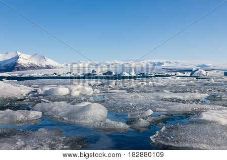 Beautiful Ice breaking natural lagoon with clear blue sky background Iceland winter season natural landscape background