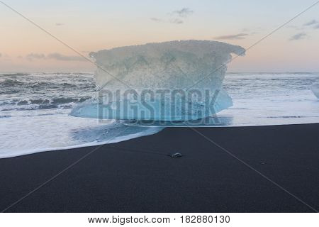 Ice breaking from iceberge on black sand beach Iceland winter season landscape background