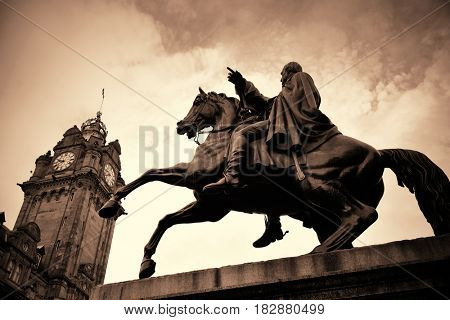 The Duke of Wellington Statue and bell tower of Balmoral Hotel in Edinburgh.