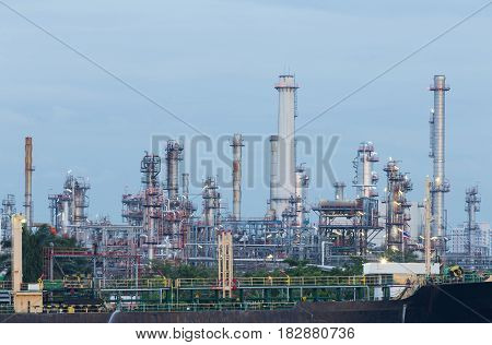 Oil refinery factory industrial power pland with blue sky background