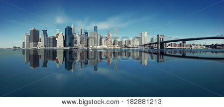 Brooklyn Bridge and downtown Manhattan skyline reflection in New York City
