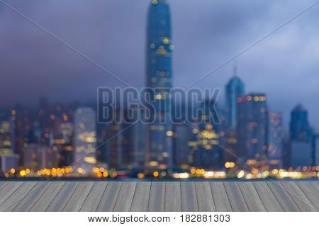 Opening wooden floor Night blurred bokeh light Hong Kong office building abstract background
