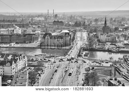 Szczecin Poland - April 01 2017: Black and white aerial view of the city downtown with bridge over Odra river.