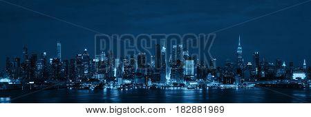 Manhattan midtown skyscrapers and New York City skyline at night panorama
