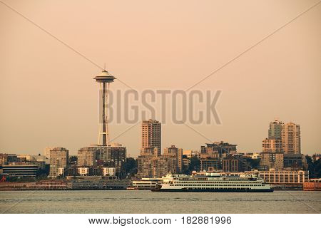 Seattle city skyline view over sea with urban architecture and Space Needle.