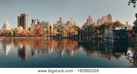 Central park Manhattan east side luxury building panorama over lake in Autumn in New York City.