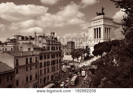 Street view with National Monument to Victor Emmanuel II in Rome, Italy.