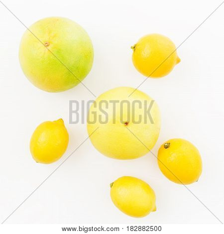 Fresh lemon and sweetie fruits on white background. Flat lay, top view.