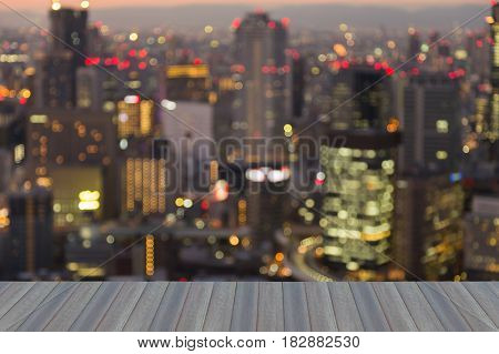 Opeing wooden floor Osaka city blurred bokeh light night view abstract background