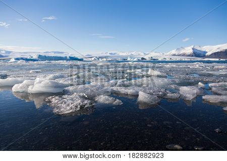Ice breaking over Jakulsarlon winter lake with clear blue sky background Iceland winter landscape background