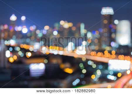 City blurred bokeh light and highway road abstract background