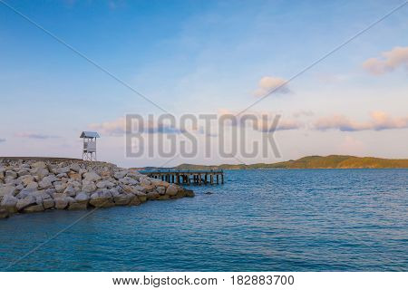 White small lifeguard tower seacoast skyline natural background