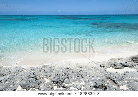 The view of a rocky beach on uninhabited island Half Moon Cay (Bahamas).