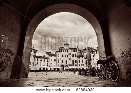 Arch entrance of Piazza dell Anfiteatro in Lucca Italy