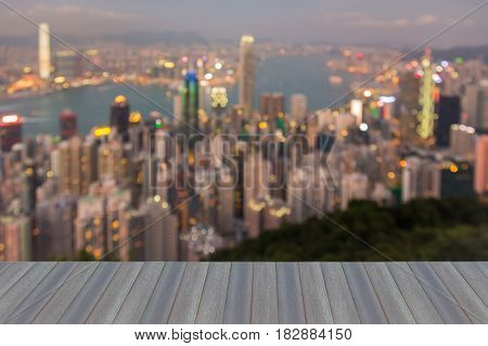 Opening wooden floor Night blurred bokeh light Hong Kong business downtown abstract background