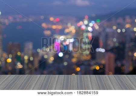Twilight blurred bokeh light Hong Kong city downotwn opening wooden floor abstract background