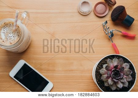 Empty Space For Text. Flat Lay Background With Phone, Rouge, Shadows, House Plant, Coffee On The Tab