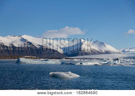 Natural winter langoon with snow mountain background Iceland winter natural landscape