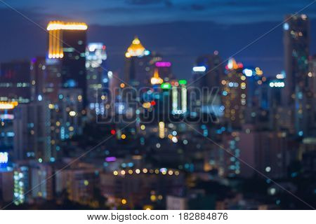 Night blurred bokeh city light office building abstract background