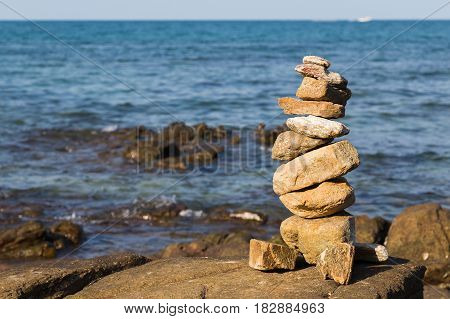 Natural strack stone over seacoast natural abstract background