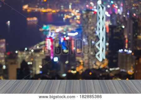 Opening wooden floor Hong Kong city blurred night light aerial view abstract background