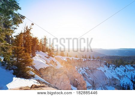 Sun bright snowcapped hills of Bryce Canyon National Park in Utah, USA