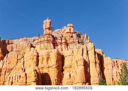 Huge sandstone mountains of Bryce Canyon National Park against blue sky