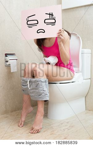 woman take confuse billboard with constipation in the bathroom