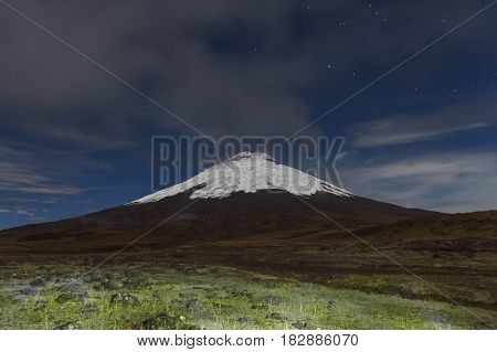Cotopaxi volcano at a clear night with stars