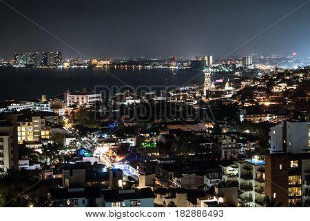 Night scene looking north over downtown Puerto Vallarta and Banderas bay