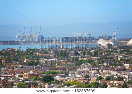 Aerial view of Long Beach harbor - biggest shipping port of USA with containers, hoists and ships