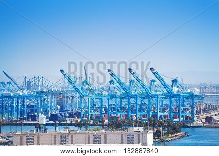 Long Beach shipping and container port with cranes loading cargo, USA